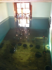 Weights in the room to keep it under water